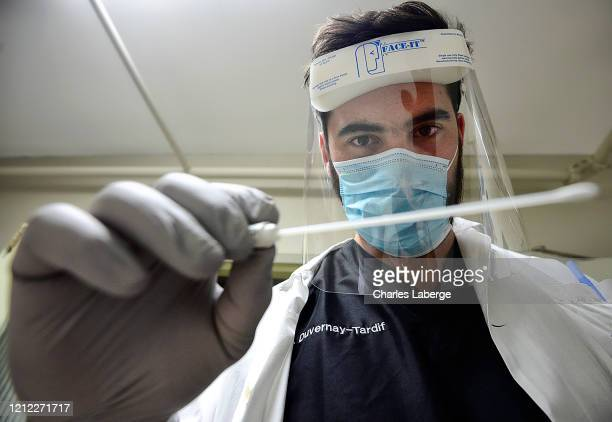 Closeup portrait of Kansas City Chiefs offensive guard Laurent DuvernayTardif holding swab during photo shoot at longterm care facility...