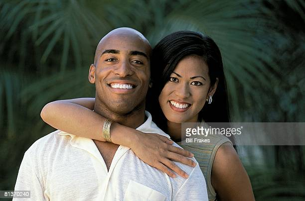 Football Closeup portrait of Tampa Bay Buccaneers Ronde Barber and wife Claudia at home Tampa FL 7/11/2001