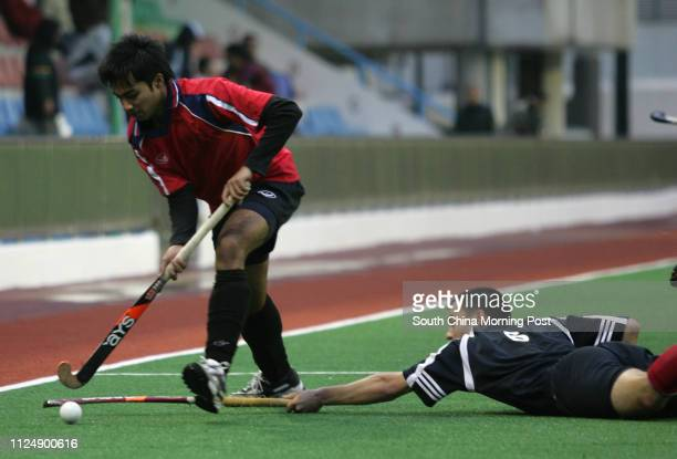 Football Club Patrick Fok tries to stop Shaheen Mustafar Mohammad from penetration during a match at the King's Park hockey pitch 22 January 2006