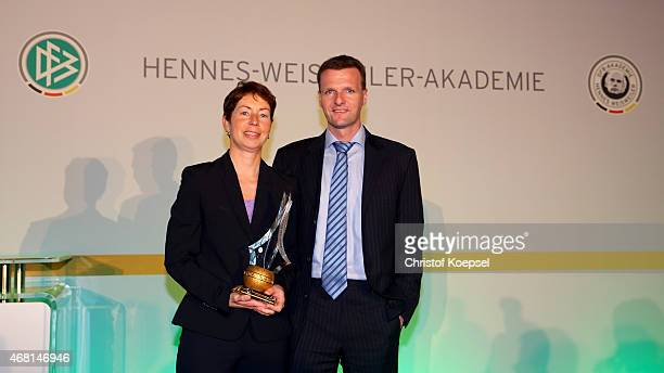 Football coach Maren Meinert was honoured as the coach of the year of the German Football Association and poses wit his husband Andreas Guido during...