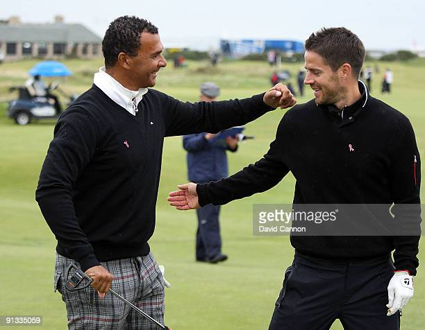 Football coach Ruud Gullit and football pundit Jamie Redknapp pat each other on the back on the 17th tee during the second round of The Alfred...