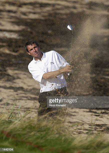 Football commentator Alan Hansen plays off the beach on the 14th hole during the first practice round for the Dunhill Links Championship at...