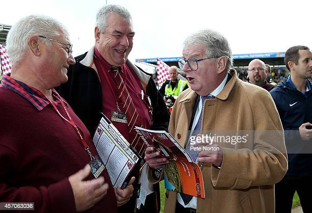 Football commentator John Motson looks at the team sheet before announcing the line up's prior to the Sky Bet League Two match between Northampton...