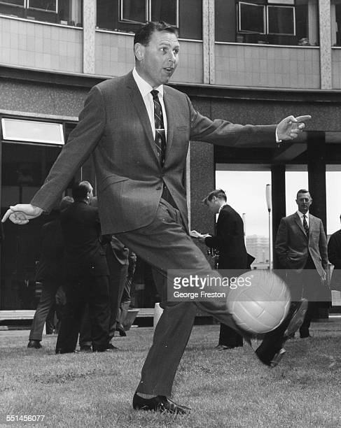 Football commentator Kenneth Wolstenholme kicking a ball around outside BBC Television Centre prior to the FIFA World Cup in Shepherds Bush London...