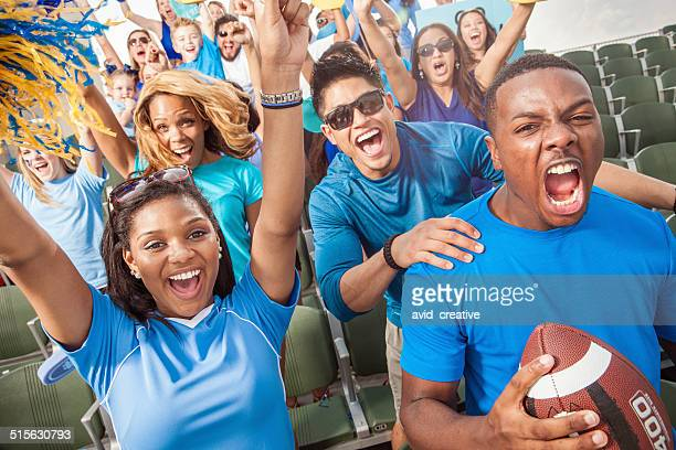 football crowd cheering for their sports team - american football sport stock pictures, royalty-free photos & images