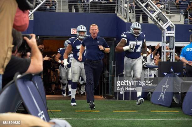 Dallas Cowboys caoch Jason Garrett taking field with players before game vs Los Angeles Chargers at ATT Stadium Arlington TX CREDIT Greg Nelson