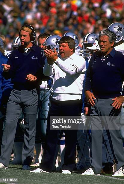 Football Dallas Cowboys coach Jimmy Johnson with assistant coach Butch Davis during game vs Green Bay Packers Green Bay WI 10/8/1989