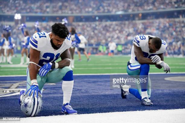 Dallas Cowboys Ezekiel Elliott and Dez Bryant down on one knee in end zone praying before game vs Los Angeles Rams at ATT Stadium Arlington TX CREDIT...