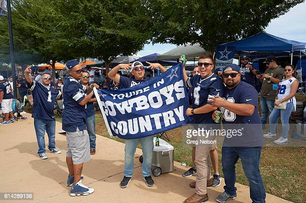 Dallas Cowboys fans holding banner that reads YOU'RE IN COWBOYS COUNTRY before game vs Cincinnati Bengals at ATT Stadium Arlington TX CREDIT Greg...