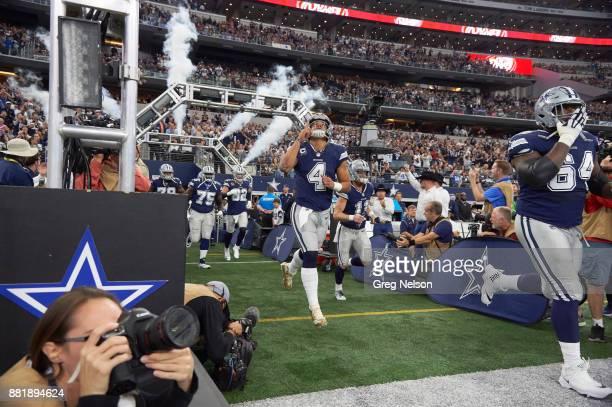 Dallas Cowboys QB Dak Prescott taking field with teammates before game vs Los Angeles Chargers at ATT Stadium Arlington TX CREDIT Greg Nelson