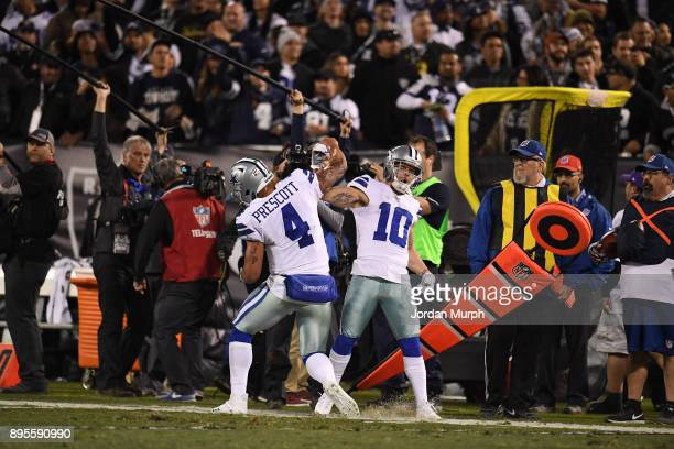 Dallas Cowboys QB Dak Prescott victorious with Ryan Switzer during game vs Oakland Raiders at Oakland Alameda Coliseum Oakland CA CREDIT Jordan Murph