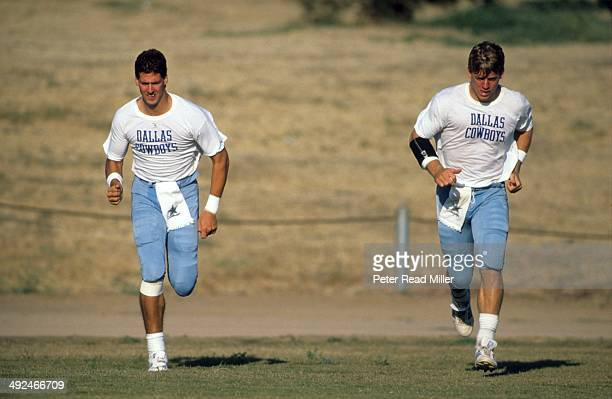Dallas Cowboys QB Troy Aikman and QB Steve Walssh jogging on field during training camp at California Lutheran College Thousand Oaks CA CREDIT Peter...