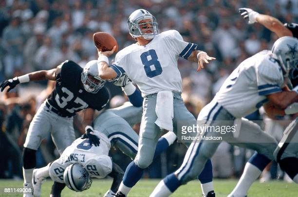 Dallas Cowboys QB Troy Aikman in action making pass vs Oakland Raiders at OaklandAlameda County Coliseum Oakland CA CREDIT Richard Mackson