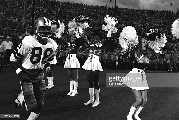 Dallas Cowboys Reggie Rucker entering field and surrounded by cheerleaders before preseason game vs Green Bay Packers at Cotton Bowl Stadium Dallas...