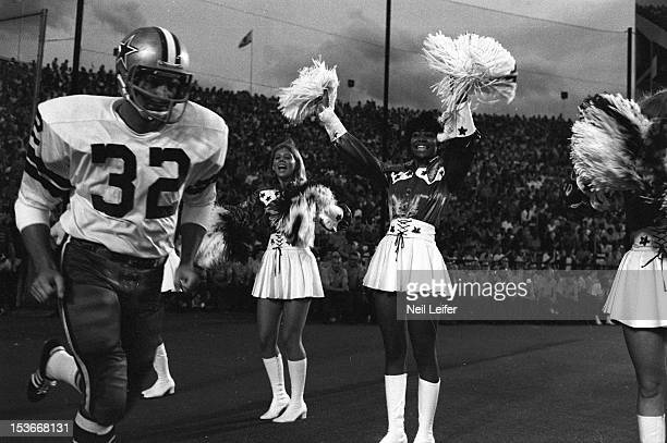 Dallas Cowboys Walt Garrison entering field and surrounded by cheerleaders before preseason game vs Green Bay Packers at Cotton Bowl Stadium Dallas...