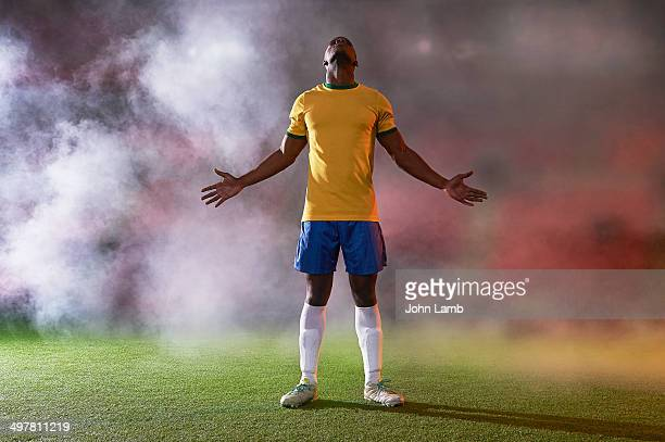 football deliverance - arms outstretched stock pictures, royalty-free photos & images
