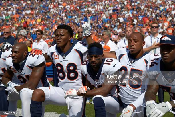 Denver Broncos Aqib Talib Demaryius Thomas Emmanuel Sanders Chris Harris and Will Parks kneeling in solidarity during the National Anthem before game...