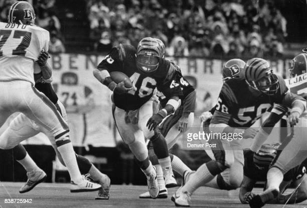 Football Denver Broncos Bengal's running back Pete Johnson barrels through a gaping hole as Broncos' Greg Boyd and Tom Jackson are shoved aside...