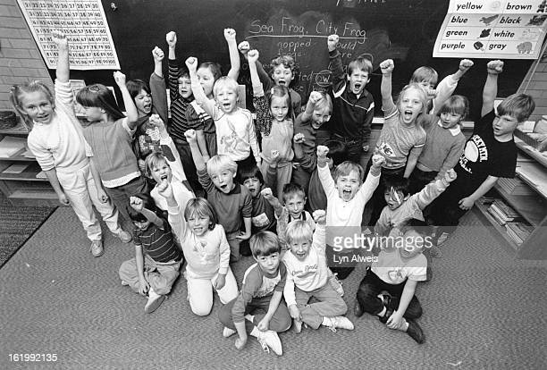 Football - Denver Broncos - Fans; Peck Elementary; Elaine Whistler's First Grade Class at Peck Elementary school in Arvada give a Bronco cheer. Yea,...