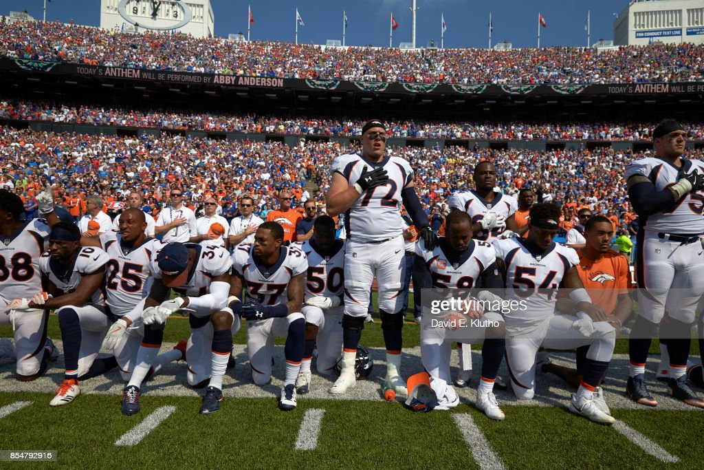 Denver Broncos Garett Bolles (72) and Derek Wolfe (95) with teammates kneeling and linking arms in a show of solidarity during the National Anthem before game vs Buffalo Bills at Ralph Wilson Stadium. David E. Klutho TK1 )