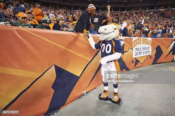 Denver Broncos mascot Miles on field with fans before game vs Green Bay Packers at Sports Authority Field at Sports Authority Field at Mile High...