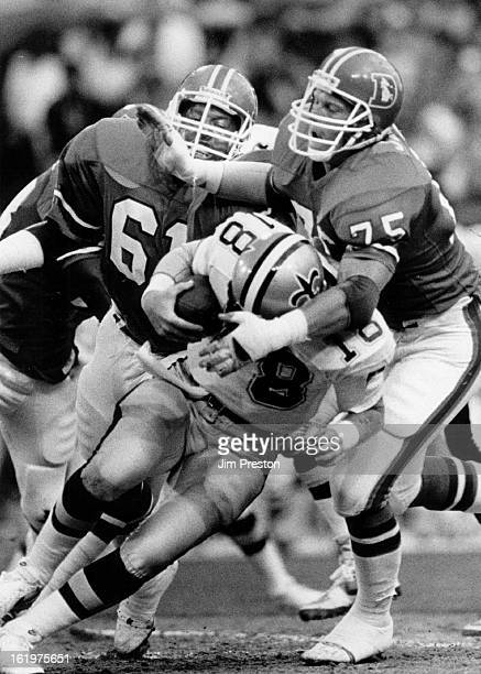 AUG 9 1986 AUG 10 1986 Football Denver Broncos New Orleans quarter back Dave Wilson is sacked by Rulon Jones as Andre Townsend lands a hand