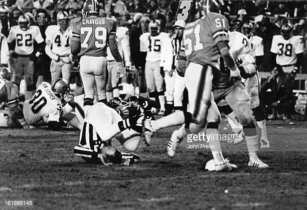 Football - Denver Broncos ; Official Head Lines Mann John Keck Knock down during the fourth Qtr: 52 Sec Left;