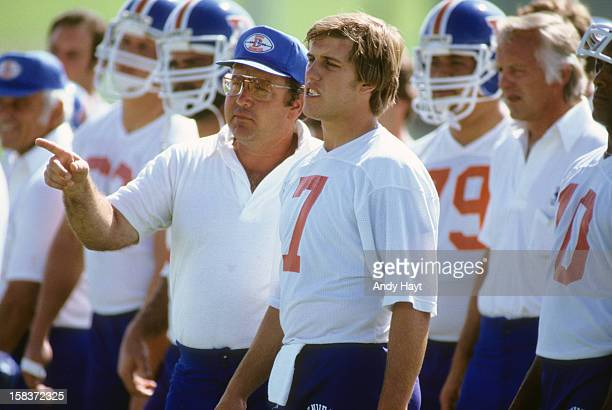 Denver Broncos QB John Elway with quarterbacks coach John Hadl during practice at University of Northern Colorado Greeley CO CREDIT Andy Hayt