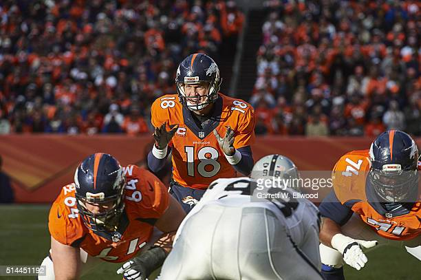Denver Broncos QB Peyton Manning calling signals before snap during game vs Oakland Raiders at Sports Authority Field at Mile High Denver CO CREDIT...