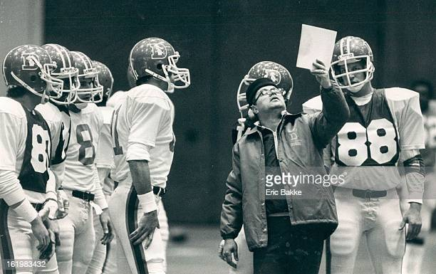 DEC 21 1983 DEC 22 1983 Football Denver Broncos Running back coach Nick Nicolas shows a play to the offense during practice Wednesday