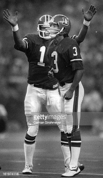 SEP 8 1983 OCT 10 1983 Football Denver Broncos Steve DeBerg gets as big a kick out of successful field goal as Rich Karlis