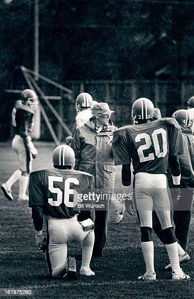 SEP 14 1983 SEP 15 1983 Football Denver Broncos The coaches Such as Joe Collier needed their rain gear at the Broncos' practice Wednesday afternoon