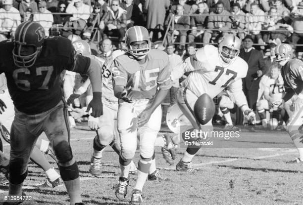 Denver QB Marlin Briscoe in action pitching out vs Oakland Raiders at Mile High Stadium Denver CO CREDIT Carl Iwasaki