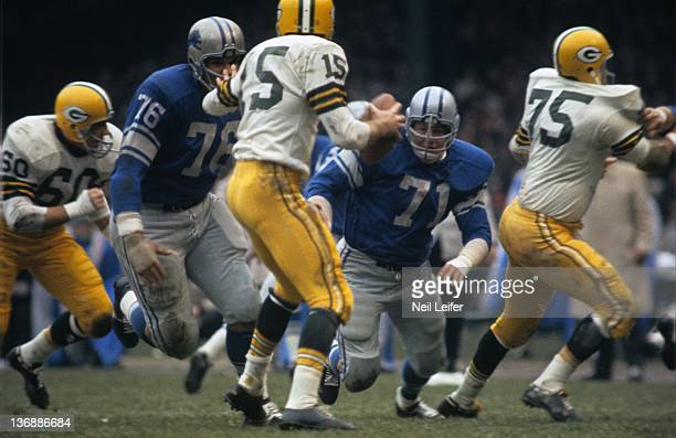 Football Detroit Lions Alex Karras and Roger Brown in action defense vs Green Bay Packers QB Bart Starr at Tiger Stadium Detroit MI CREDIT Neil Leifer