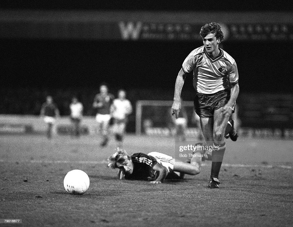 Football. Division One. 18th December 1982. Watford 2 v Ipswich Town 1. Watford's Richard Jobson races past Ipswich's Trevor Putney. : News Photo