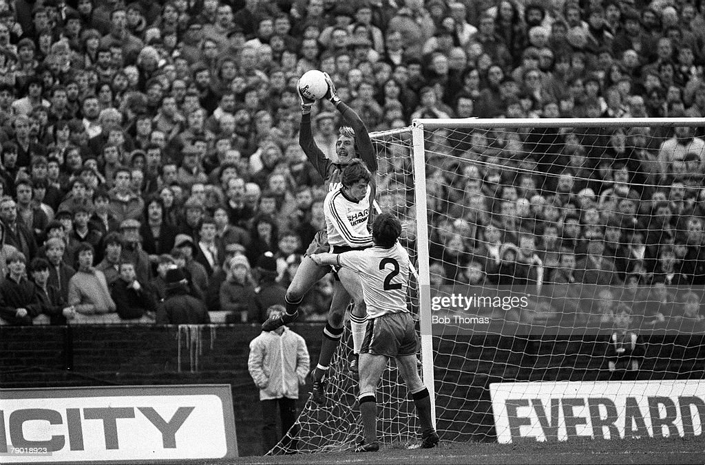 Football, Division One, 4th December 1982, Watford 0 v Manchester United 1, Watford goalkeeper Steve Sherwood catches the ball under pressure from United's Arnold Muhren as Pat Rice (2) looks on
