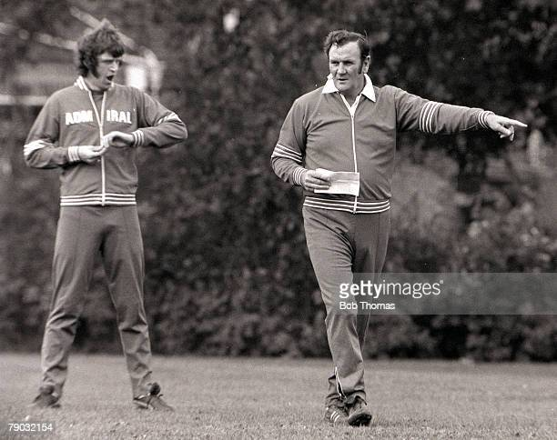Football England manager Don Revie takes charge of an England training session as Mike Channon yawns in the background