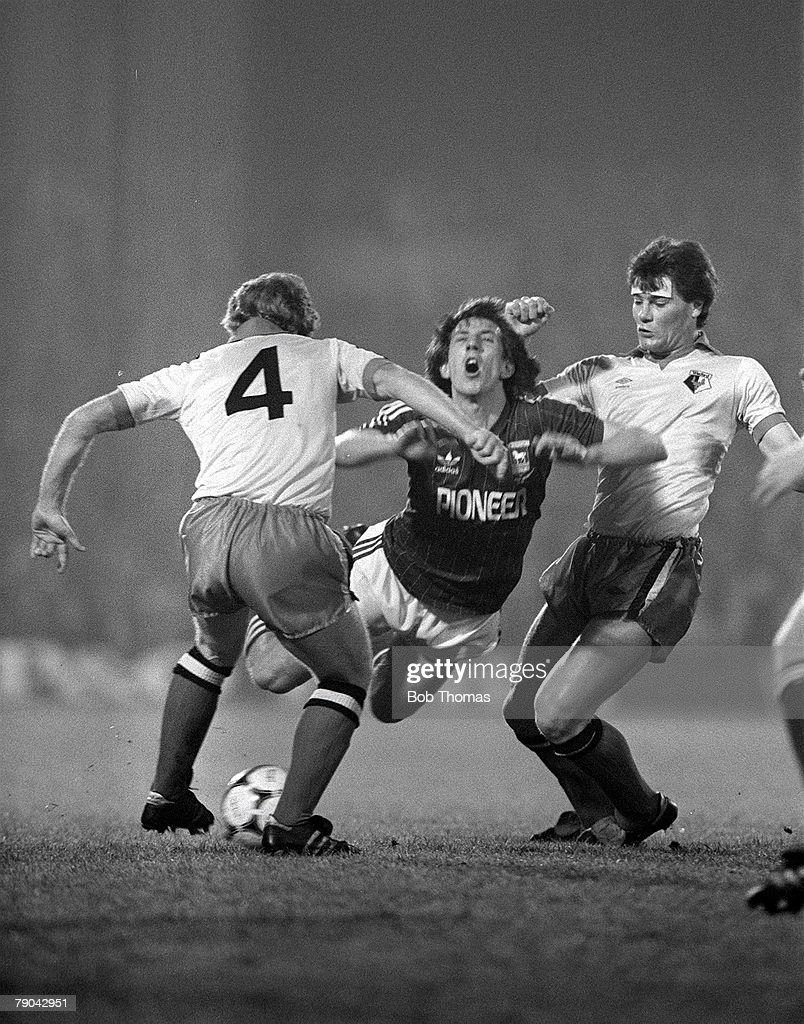 Football. English League Cup 5th Round. Ipswich, England. 18th January 1982. Ipswich Town 2 v Watford 1. Ipswich's Paul Mariner is fouled by Watford's Steve Terry (right) as Les Taylor looks on. : News Photo