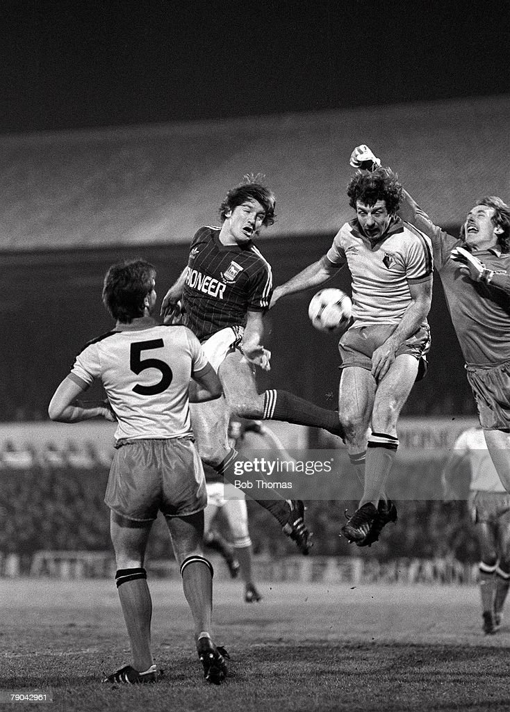 Football, English League Cup 5th Round, Ipswich, England, 18th January 1982, Ipswich Town 2 v Watford 1, Ipswich's Russell Osman leaps up to head the ball with his goalkeeper Steve Sherwood and Watford's Gerry Armstrong