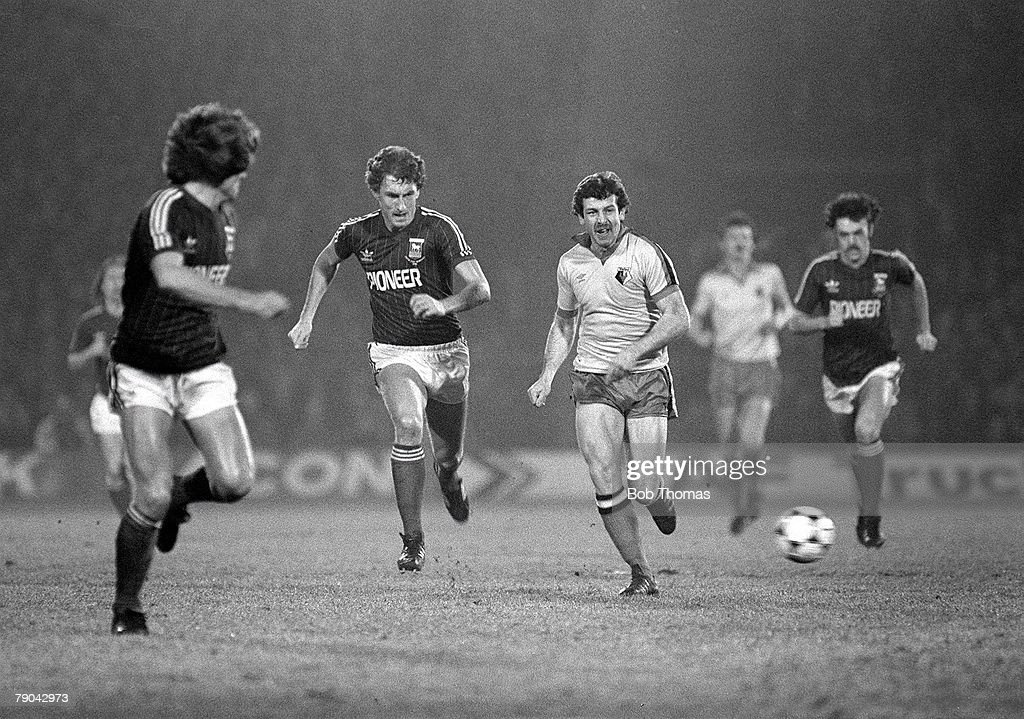 Football, English League Cup 5th Round, Ipswich, England, 18th January 1982, Ipswich Town 2 v Watford 1, Watford's Gerry Armstrong is chased for the ball by Ipswich's Terry Butcher