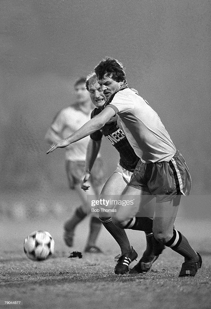 Football. English League Cup 5th Round. Ipswich, England. 18th January 1982. Ipswich Town 2 v Watford 1. Watford's Ian Bolton is challenged for the ball by Ipswich's Alan Brazil. : News Photo