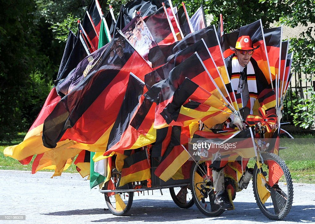 Football enthousiast Christian Roenner drives his bicycle decorated with 210 German flags on June 16, 2010 in Duesseldorf, western Germany. Roenner tries to get an entry in the Guinness Book of World Records.