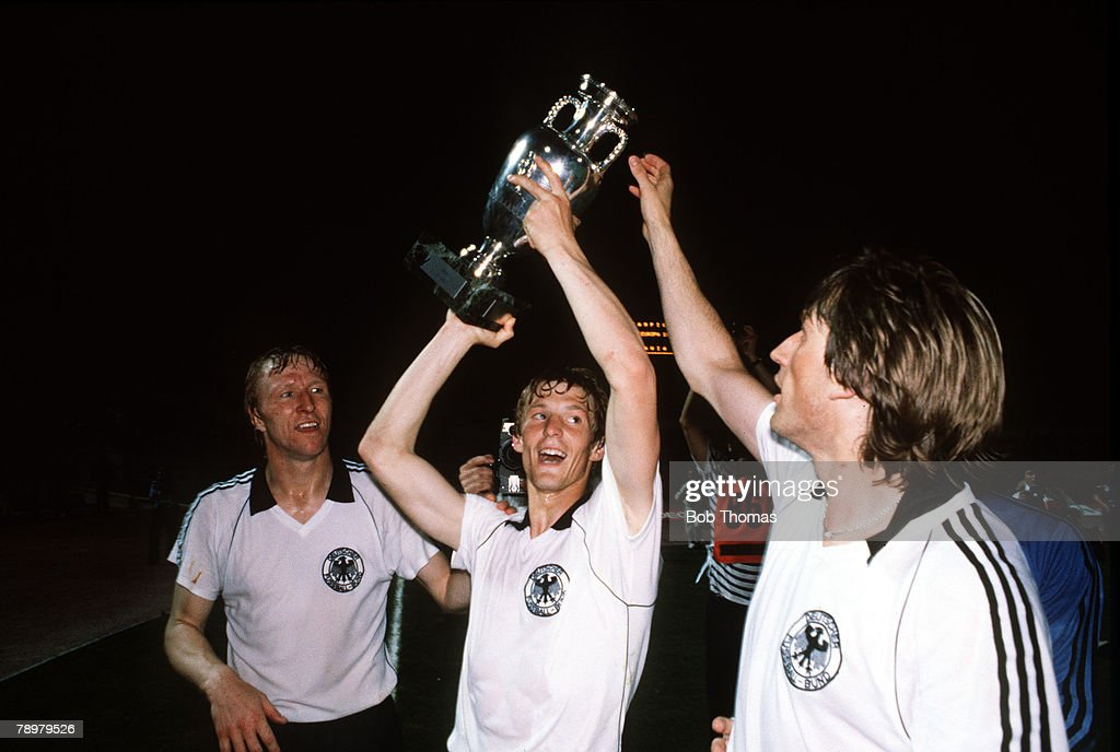 Football. European Championships. Final. Rome, Italy. 22nd June 1980. West Germany 2 v Belgium 1. West Germany's L-R: Horst Hrubesch, Karl-Heinz Foerster and Manny Kaltz celebrate with the trophy after the match. : News Photo