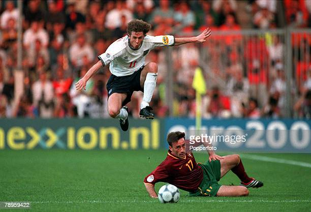Football, European Championships , Philips Stadium, Eindhoven, Holland, Portugal 3 v England 2, 12th June England+s Steve McManaman leaps to take...