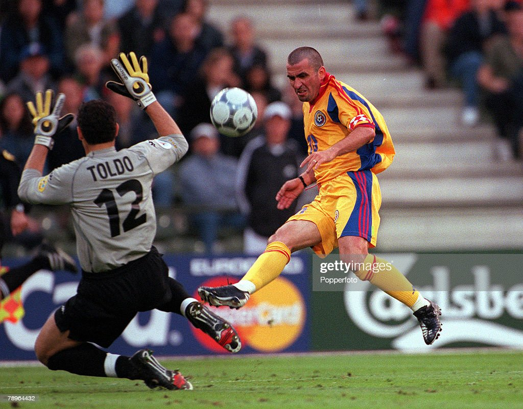 Football. European Championships Quarter Final. (EURO 2000). Brussels, Belgium. 24th June, 2000. Italy 2 v Romania 0. Italian goalkeeper Francesco Toldo comes off his line to block a shot from Romania's Gheorghe Hagi. : News Photo
