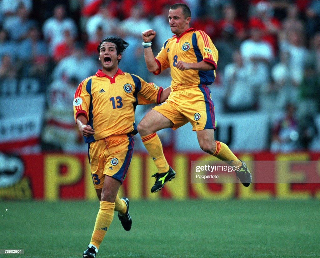 Football. European Championships (EURO 2000). Stade du Pays de Charleroi, Belgium. England 2 v Romania 3. 20th June, 2000. Romania+s Dorinel Munteanu jumps for joy after scoring the goal to equalise at 2-2. Joining him in his celebrations is Cristian Chiv : News Photo