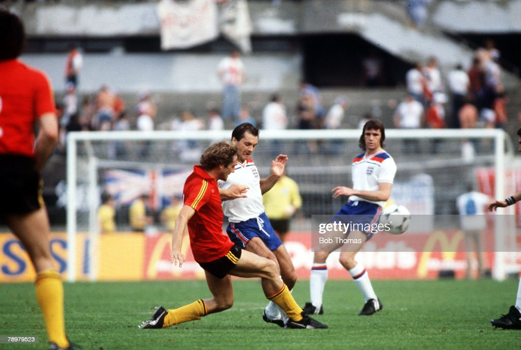 Football, European Championships, Turin, Italy, 12th June 1980, England 1 v Belgium 1, England's Ray Wilkins is challenged for the ball by Belgium's Walter Meeuws during their Group Two match