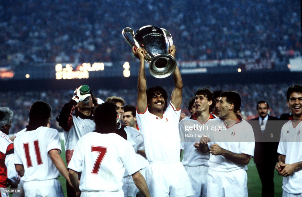 Football. European Cup Final. Nou Camp, Barcelona, Spain. 24th May 1989. AC Milan 4 v Steaua Bucharest 0. AC Milan Ruud Gullit holds the trophy aloft as he celebrates with his team-mates. : News Photo