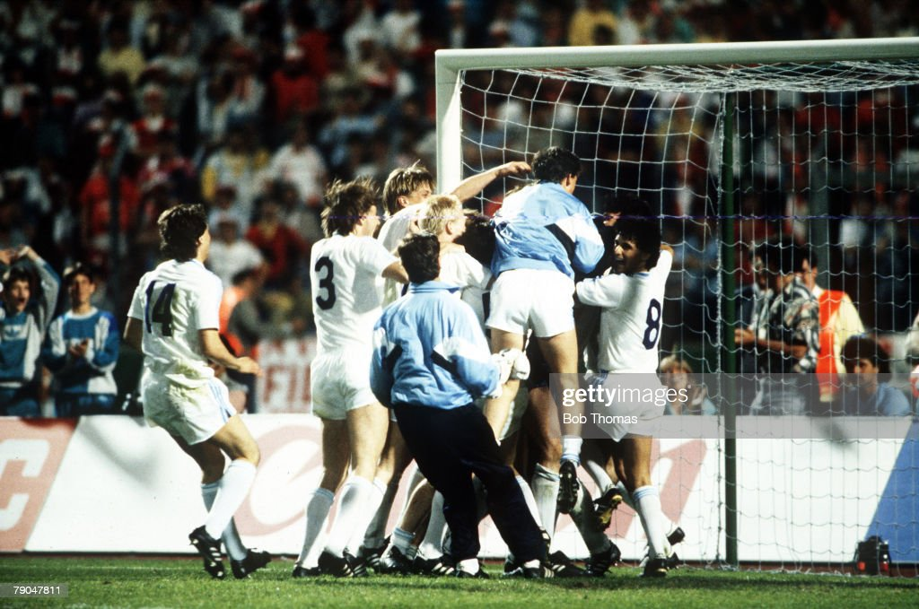 Football. European Cup Final. Stuttgart, West Germany. 25th May 1988. Benfica 0 v PSV Eindhoven 0 (after extra time, PSV win 6-5 on penalties). PSV players leap onto goalkeeper Hans Van Breukelen after he saved the vital penalty in the shoot-out. : News Photo