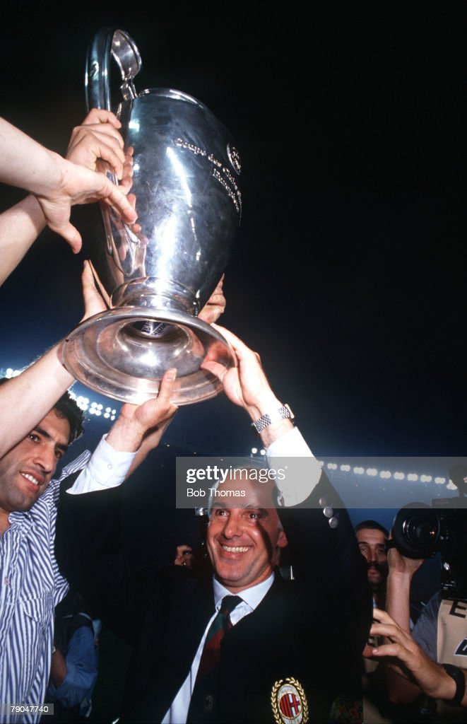 Football, European Cup Final, Vienna, Austria, 23rd May 1990, AC Milan 1 v Benfica 0, AC Milan coach Arrigo Sacchi holds the trophy aloft